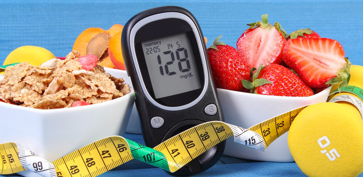 Glucose meter with sugar level, healthy food, dumbbells and centimeter, diabetes, healthy and sporty lifestyle