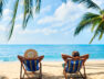 Couple relax on the beach enjoy beautiful sea on the tropical island