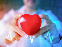 abstract background of hands holding heart model with symbol of heart pulse signal