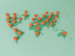 3D Illustration. Covid-19 cells on a world map.