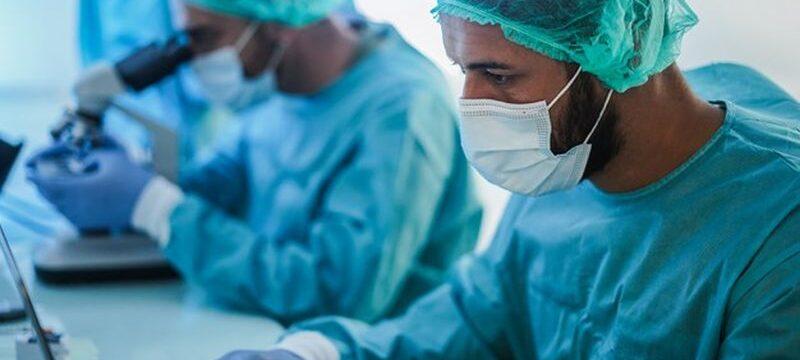 medical-workers-hazmat-suit-working-with-laptop-computer-micoroscope-inside-laboratory-hospital-during-coronavirus-outbreak_166273-983