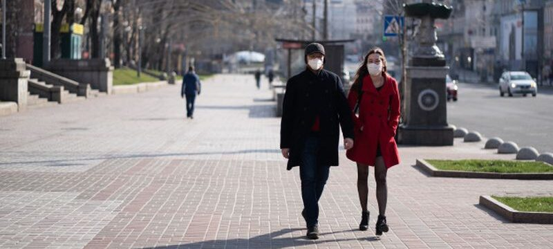 people-facial-protective-masks-almost-empty-street_1153-5033
