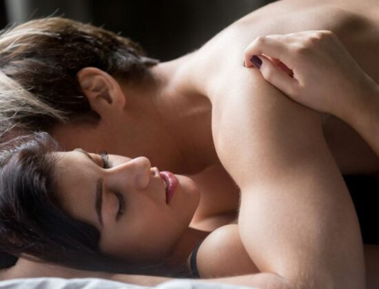 sensual-couple-having-sex-woman-embracing-lover-lying-bed_1163-4468