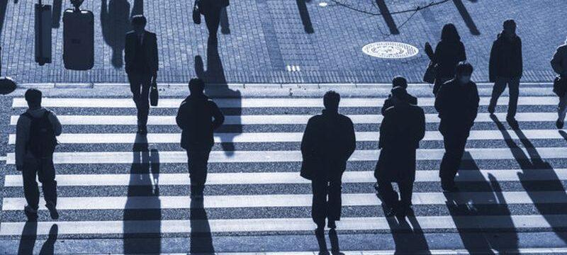 silhouette people walk on pedestrian crosswalk at the junction s