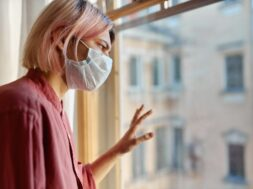 teenage-girl-with-pinkish-hair-standing-front-closed-window-with-hand-glass-looking-outside-while-staying-home-during-quarantine-coronavirus-pandemic-social-distancing-concept_343059-1917