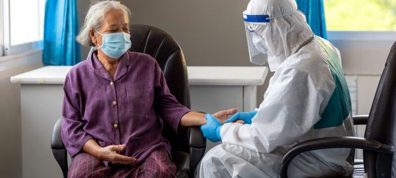 asian-doctor-is-checking-patience-s-pulse-by-fingers-medical-checking-table-aging-female-patient-that-is-risk-infection-corona-virus-covid-19_61243-746