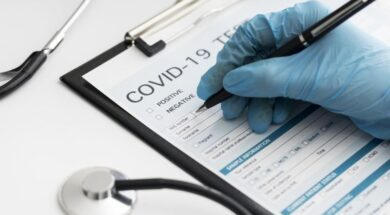 close-up-doctor-completing-covid-medical-form_23-2148747819