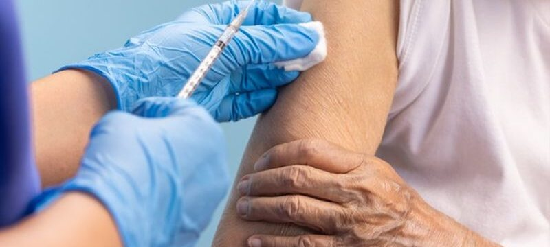 closeup-nurse-doing-vaccine-injection-senior-woman_176124-716