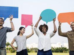 diverse-friends-holding-speech-bubbles_53876-95252