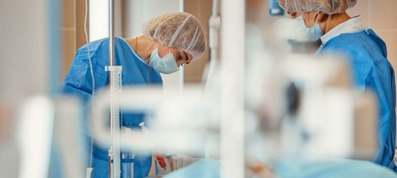 doctors-protective-masks-lab-coats-working-intensive-care_124865-6557