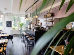 interior-shot-cafe-with-chairs-near-bar-with-wooden-tables_181624-1669