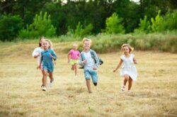 kids-children-running-meadow-summer-s-sunlight_155003-13021