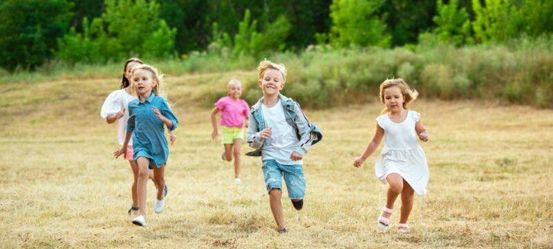 kids-children-running-meadow-summer-s-sunlight_155003-13021