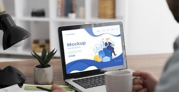man-desk-with-laptop-mock-up_23-2148782213