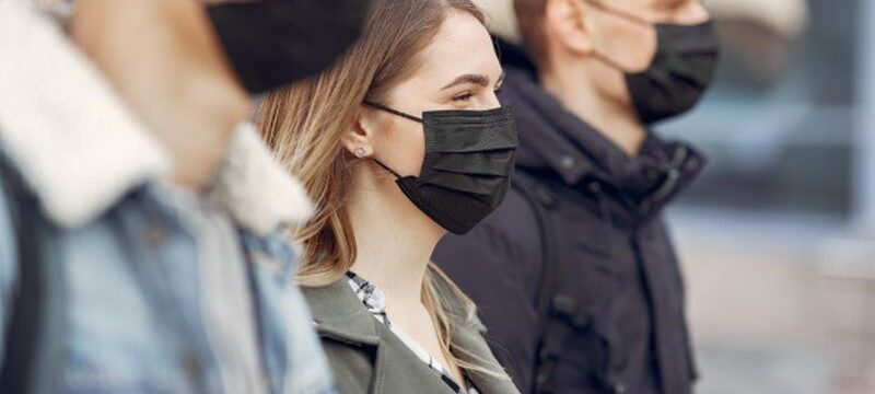 people-masks-stands-street_1157-31567