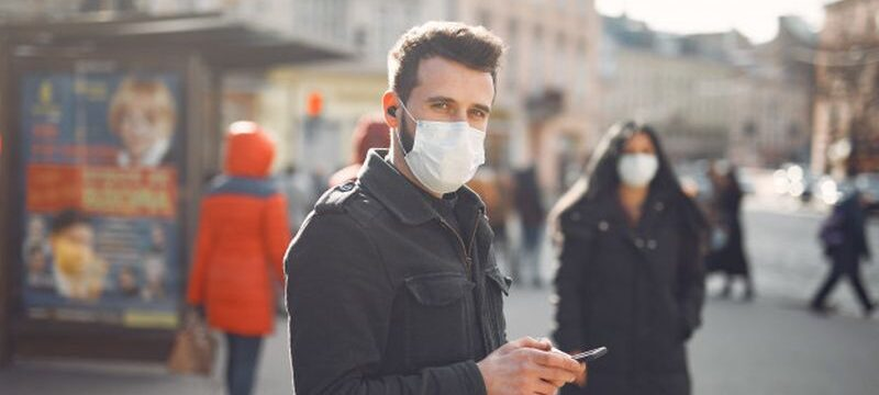 people-wearing-protective-mask-standing-street_1157-32367
