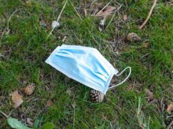 surgical-mask-lying-ground-grass_301038-869