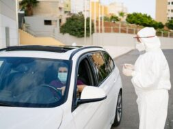 doctor-doing-pcr-test-covid-19-patient-through-car-window_147764-735