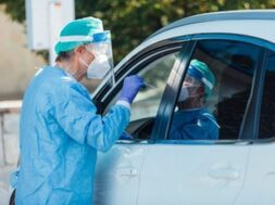 medical-personnel-wearing-ppe-performing-pcr-with-swab-their-hand-patient-inside-his-car-detect-if-he-is-infected-with-covid-19_325364-217