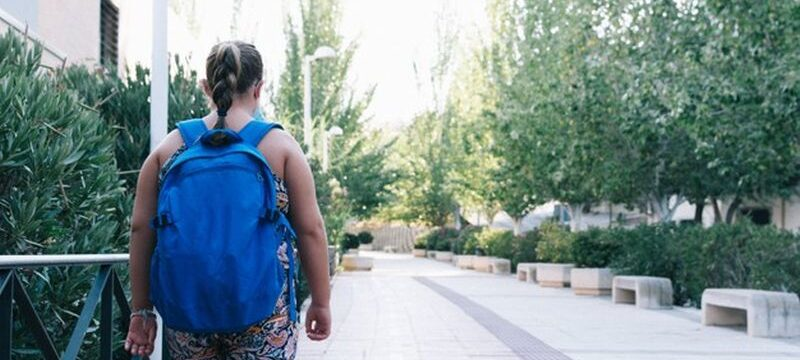obese-blonde-girl-with-blue-backpack-her-way-school_323169-141