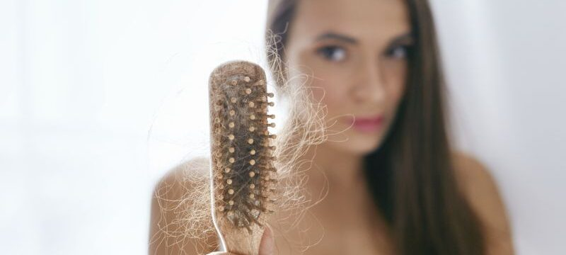 Hair Loss. Upset Woman Holding Brush With Hair