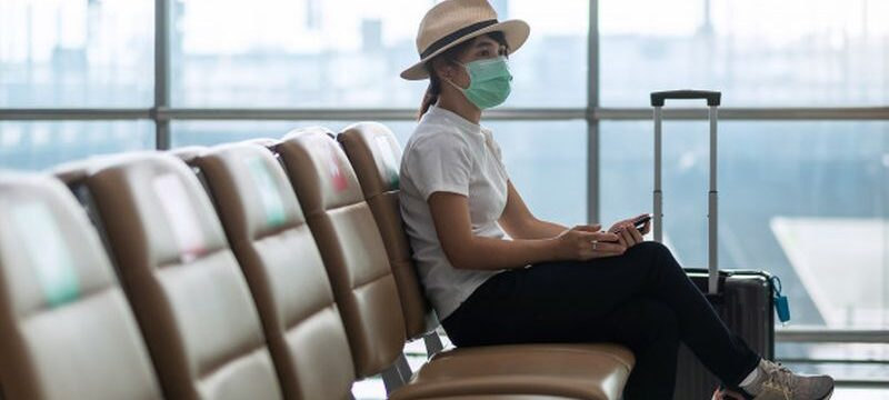 young-female-wearing-face-mask-sitting-chair-airport-protection-coronavirus-disease-covid-19-infection-asian-woman-traveler-new-normal-travel-bubble-social-distancing_42256-2704