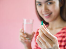 young-woman-taking-medicine-pill-after-doctor-order