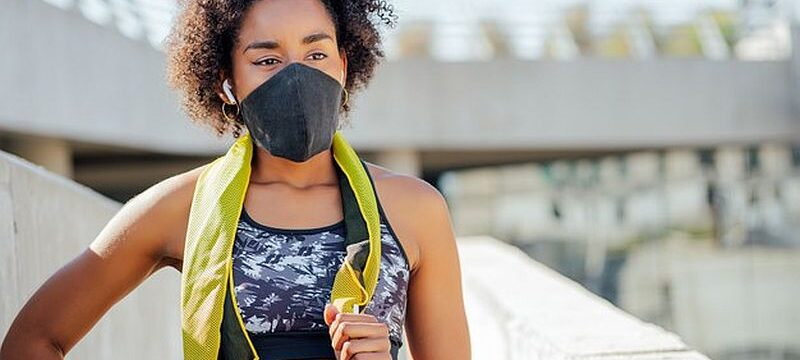 afro-athletic-woman-wearing-face-mask-relaxing-after-work-out-outdoors-street_58466-14593
