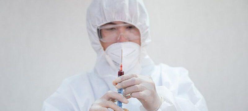 asian-male-doctor-medical-ppe-holding-syringe-injecting-blood-sample-laboratory_49071-3211