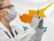 female-doctor-nurse-gloves-holding-syringe-vaccination-against-cyprus-flag_156719-731