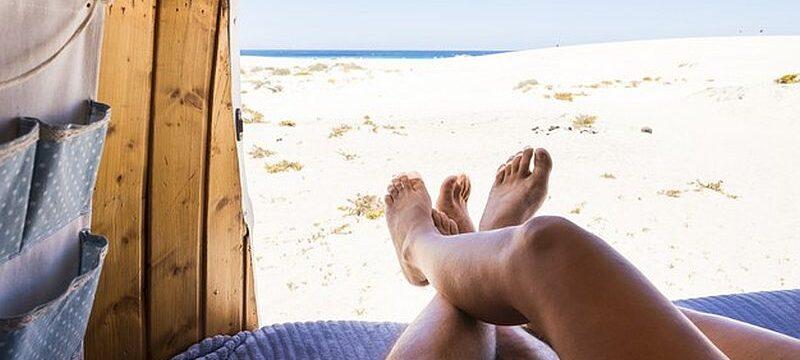 legs-point-view-romantic-couple-inside-old-van-enjoying-beach-ocean-parking-together_425263-1625