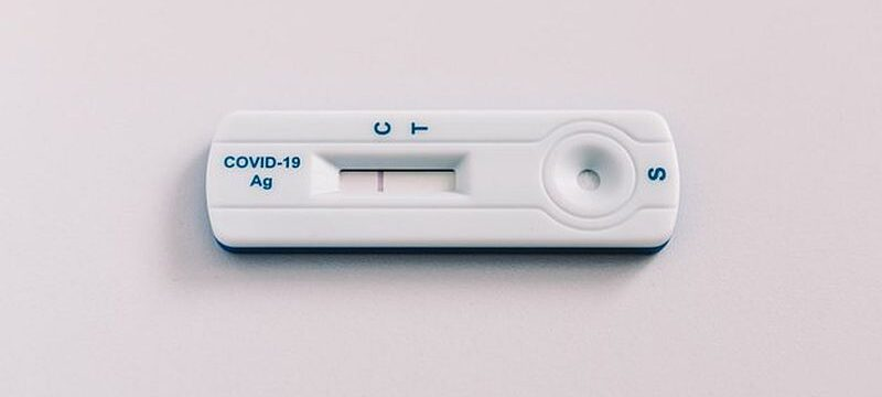 rapid-covid-19-antigen-test-with-negative-result-white-background-coronavirus-concept_325364-693