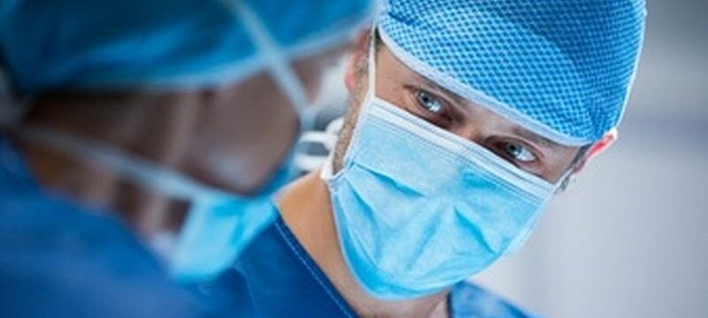 surgeons-interacting-while-performing-operation_1170-2225