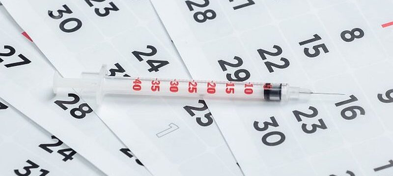 syringe-monthly-calendar-close-up-vaccination_175682-15758