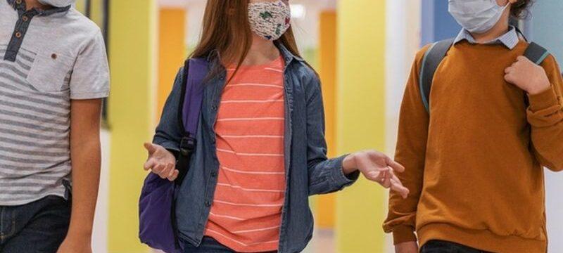 three-children-school-hallway-with-medical-masks_23-2148848289