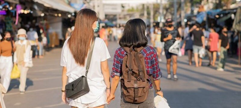 two-women-travelling-together-busy-street_1150-42469