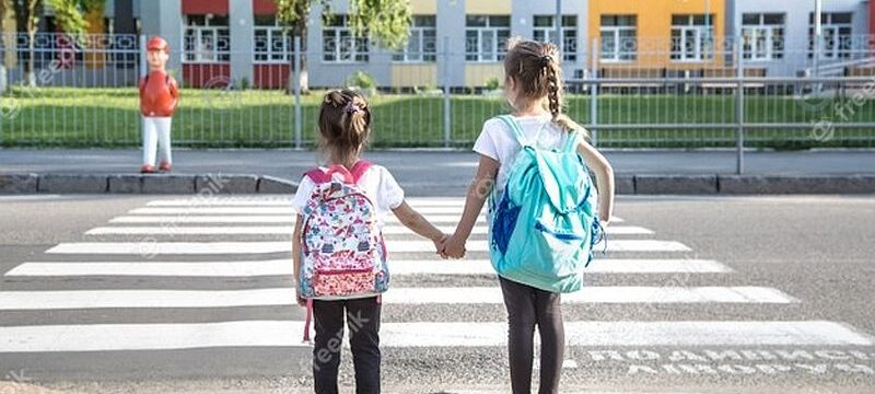 back-school-education-concept-with-girl-kids-elementary-students-carrying-backpacks-going-class_169016-6127