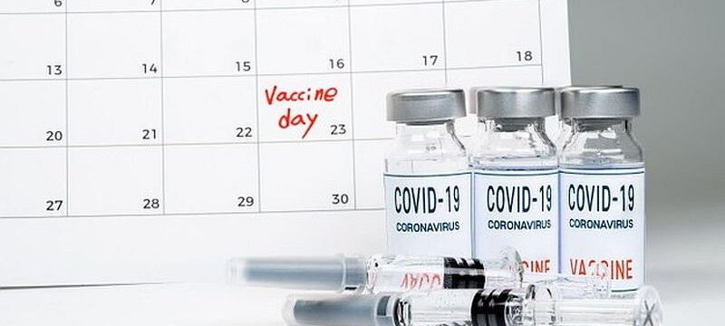 calendar-with-vaccination-dates-covid-19-vaccine-medical-concept-with-syringe_127345-992 (1)