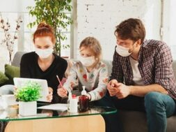 caucasian-famiy-face-masks-gloves-isolated-home-with-coronavirus_155003-40701