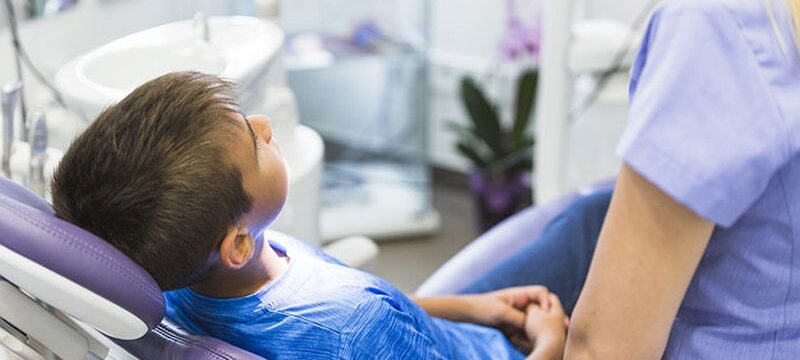 child-patient-leaning-dental-chair-clinic_23-2147906075