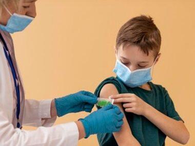 close-up-kid-doctor-wearing-masks_23-2148989356