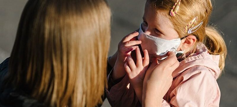 coronavirus-end-concept-no-more-covid-19-little-girl-mother-wear-masks-walk-street-mom-removes-mask-happy-child-family-with-kid-outdoors-celebrating-success-pandemic-is-has-ended_180731-209
