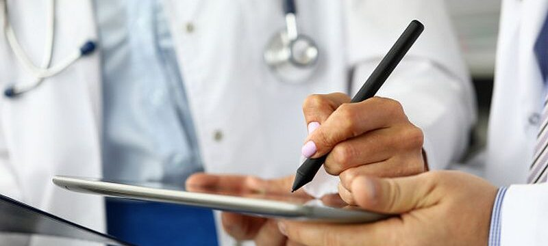 female-doctor-making-electronic-notes-tablet-pc_151013-4382