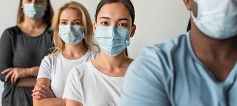group-friends-wearing-face-masks_23-2148729726
