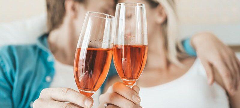 happy-couple-drinking-wine-bedroom_1150-12109