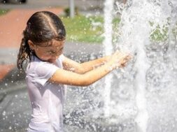happy-little-girl-among-splashing-water-city-fountain-has-fun-escapes-from-heat_169016-12597