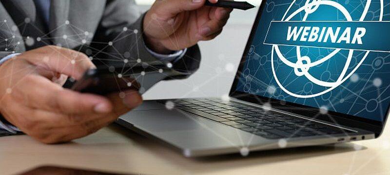man-with-laptop-showing-webinar-screen_36325-2225