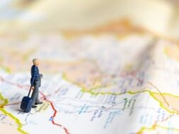 miniature-business-people-standing-map-travel-concept_29654-725