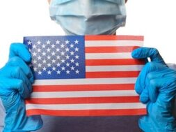 pandemic-covid-19-theme-woman-protective-gloves-medical-face-mask-holds-usa-flag-isolated-white_175682-16143