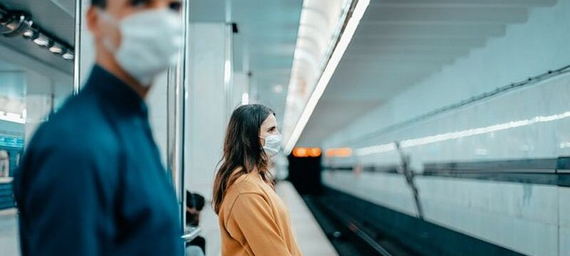 passengers-protective-masks-standing-metro-station_160672-9020